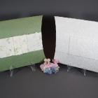 Zöld és fehér szórópárnák
