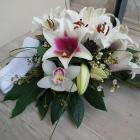 Ravataldísz liliommal, orchideával